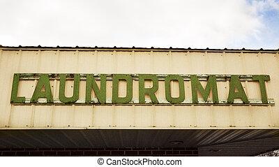 Laundromat sign - Old green Laundromat sign