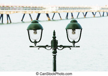 Old green light to illuminate the walkway.