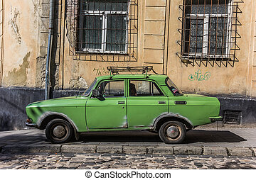 Old green Russian car in Lviv, Ukraine