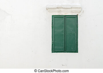 Old green window on the wall., with copy space for text.