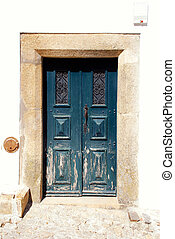 old green wooden door in white rural house, Portugal