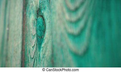 Old green wooden fence, wood texture, blur
