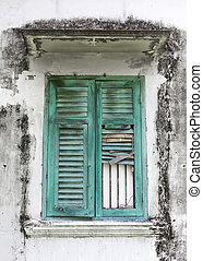 Old green woody window on Moldy wall