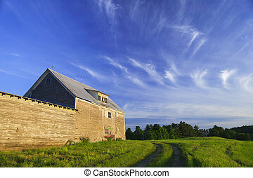 Old grey weathered barn  at sunset in Stowe, Vermont, USA