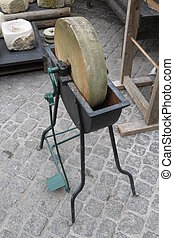 Old grindstone tool - An old single-pdeal grindstone tool to...