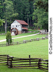 Old Grist Mill - A scenic of rustic fences, a weathered old...