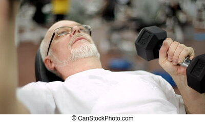 Old grizzled man with dumbbells
