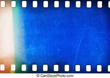 Old grunge filmstrip - Blank grainy film strip texture...