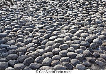 Old grunge grey cobble stone