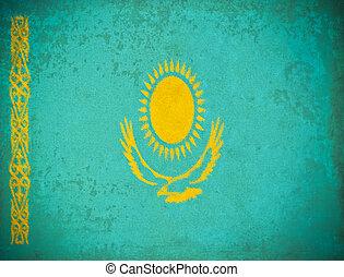 old grunge paper with Kazakhstan flag background