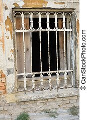 Old grungy barred window