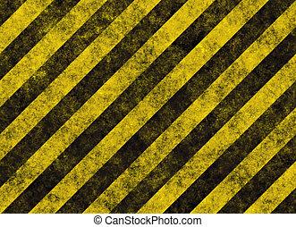 old grungy yellow hazard stripes on black road