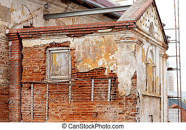Old gungy wall with immured window