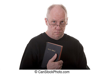 Old Guy in Black Shirt Holding Bible