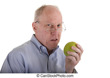 Old Guy with Apple Looking at Camera