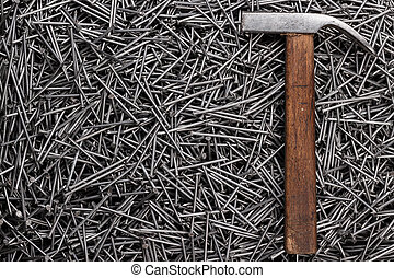 old hammer and nails on table - old hammer and nails on the ...