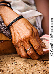 hand of an old bushman woman in kalahari desert