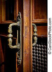 old handle on wooden door