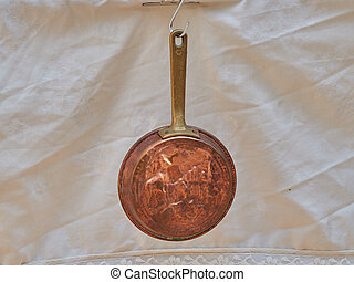 old hanging copper pan