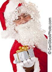 Old happy Santa Claus holding Christmas gift in hand
