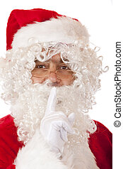 Old happy Santa Claus puts finger on lips to force silence