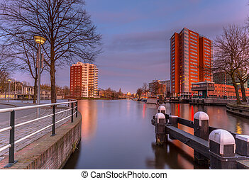 Old harbor in Groningen centre at sunset