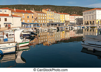 Old harbour of Cres - Boats and colorful houses reflected in...