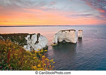 Evening scene with Old Harry rocks in eastern Dorset, UK.