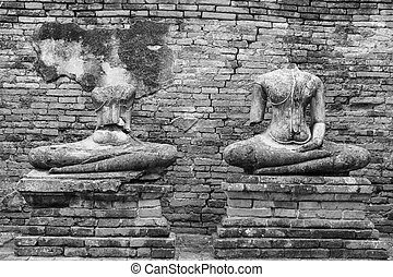 Old headless broken buddha statue at Ayutthaya Thailand in black and white