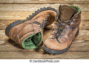 old heavy hiking boots agains wood