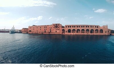 Old historic buildings near Fort Manoel view from bay,...