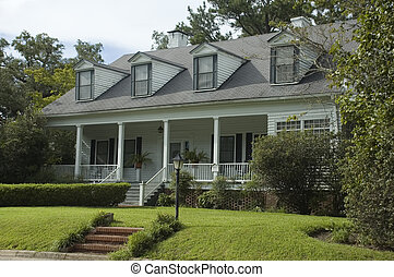 An old home with beautifully landscaped grounds.