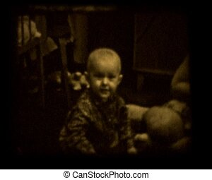 old home movie - little boy playing on real 8mm film
