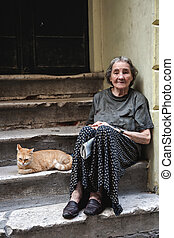 Old Homeless Woman in Poverty