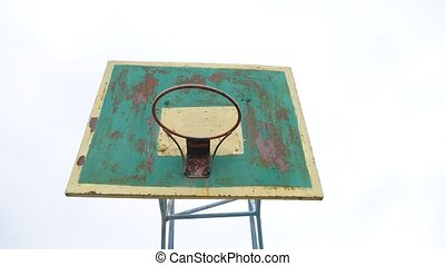 old hoop basketball bottom view outdoors rusty iron sport...