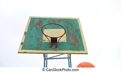 old hoop basketball bottom view outdoors rusty iron ball...