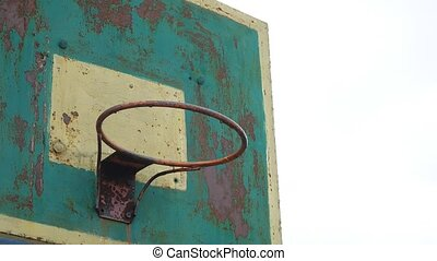 old hoop basketball bottom view outdoors sport rusty iron...