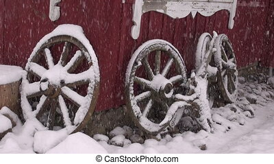 old horse carriage wheels and snow