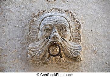 Old horse ring on wall. ischitella. Puglia. Italy.