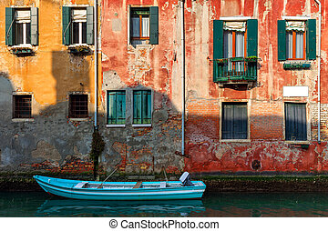 Old house and boat on canal in Venice, Italy.