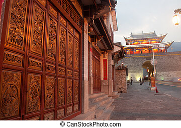 Old house and city gate in ancient city of Dali .
