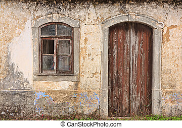 Abandoned facade with wood windows and doors in Portugal
