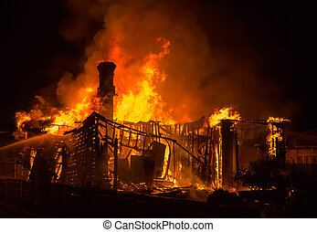 Old House Fire - Grand old brick chimney stand tall as it's...