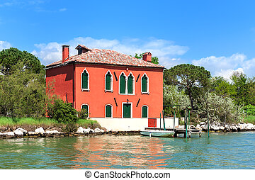 Old house on small island in Venice, Italy.