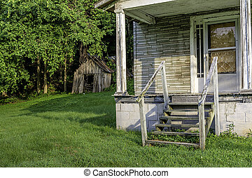 Old house porch and wooden shed