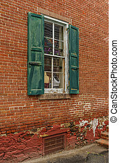 Old house red wall with green wooden window