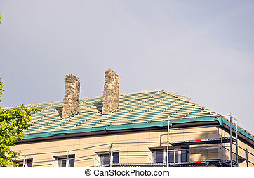 old urban house roof restoration repairing construction