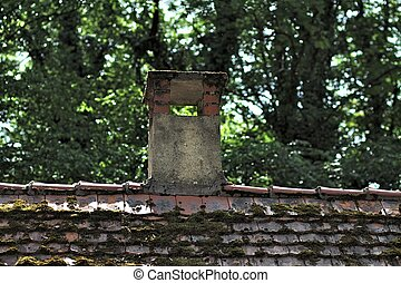 Old house roof with chimney