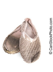 Old house slippers - A pair of old, ratty house slippers on ...