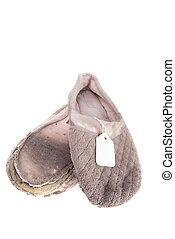 Old house slippers - A pair of old ratty house slippers with...